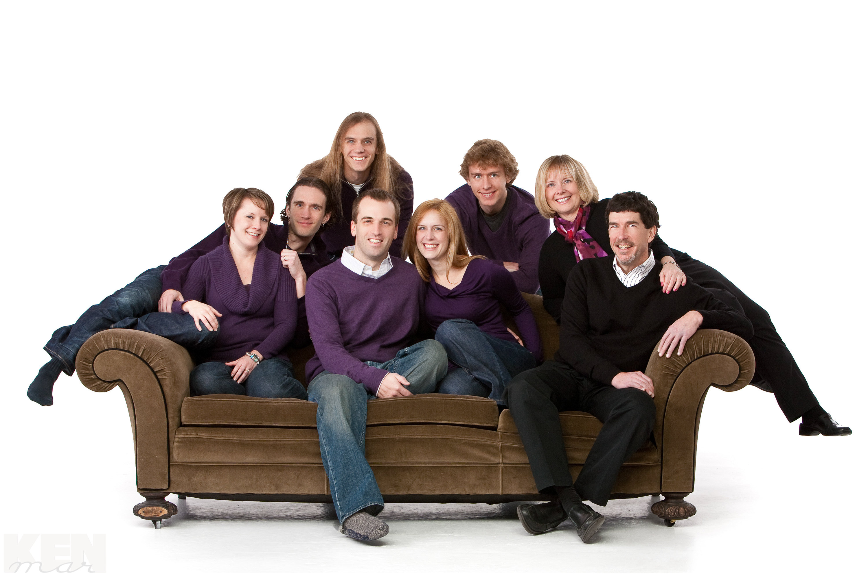 Fun, casual unposed pose of a family of 8