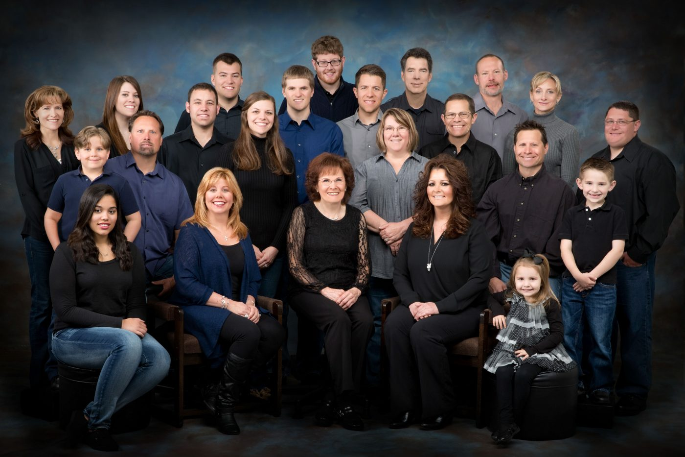 A family of 23 in black, blue and grey.