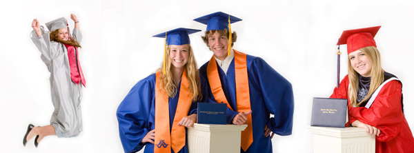 Two teenagers are posing their graduation garb including caps and gowns