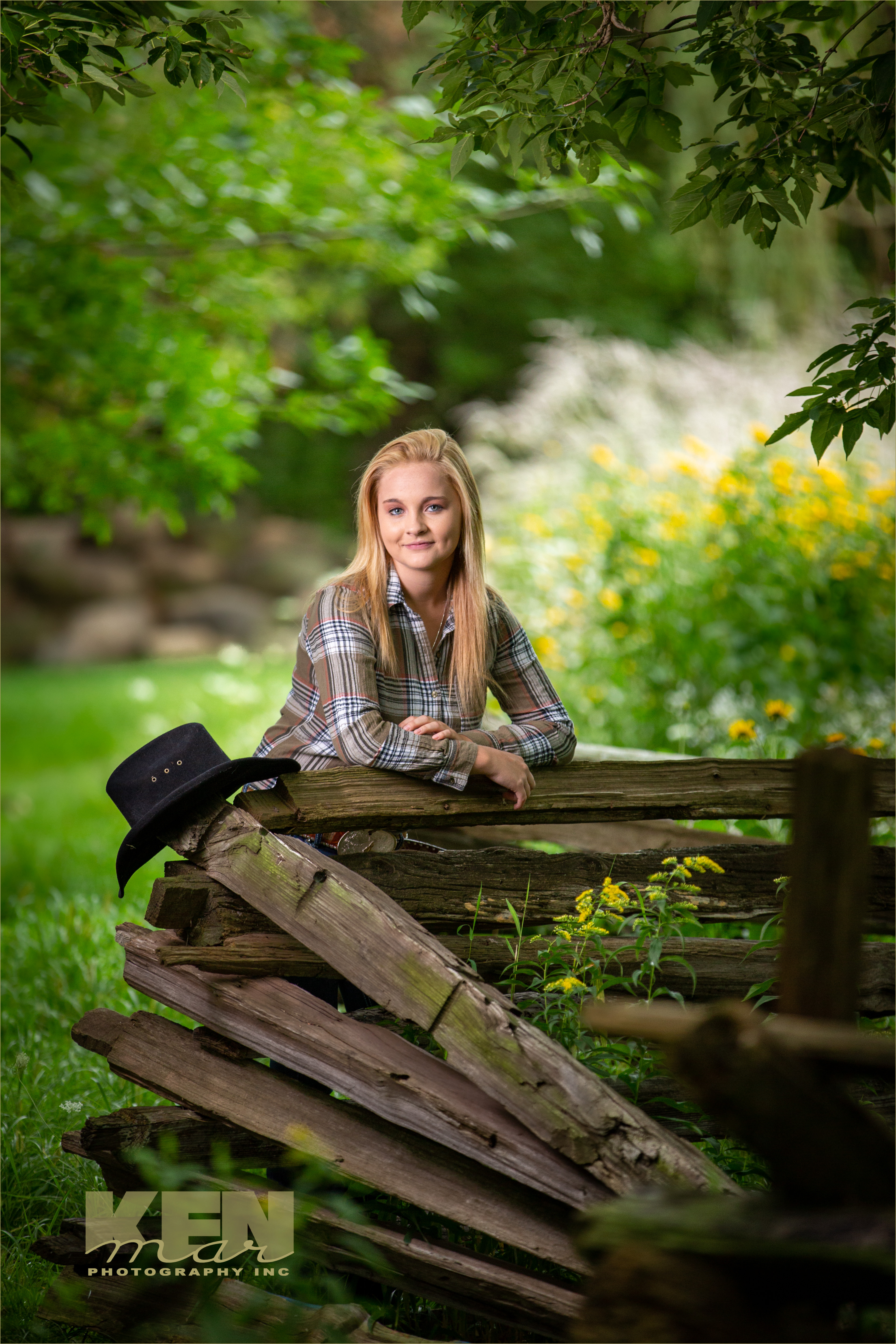 High school senior graduation pictures outdoors in a private photo park near Appleton